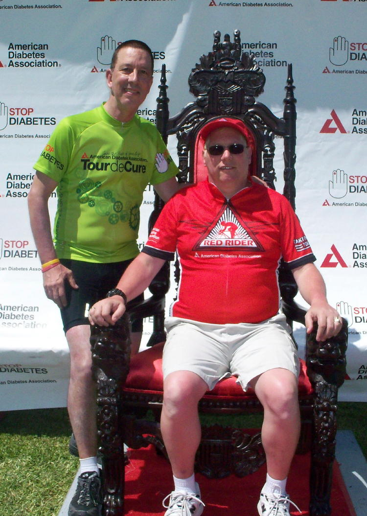 Denns and I (Dave) after completing the ride.  Dennis is enjoying his time on the throne.