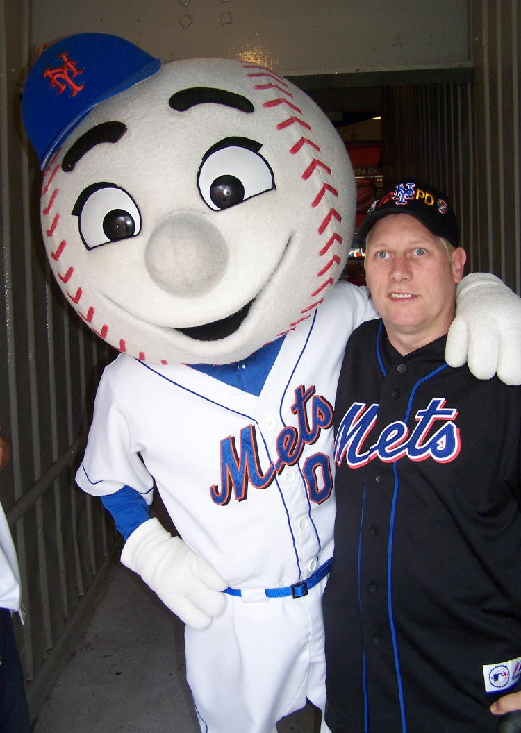 Dennis meets his pal Mr. Met.  He spoke often before our trip to New York that he wanted to meet Mr. Met.  Mr. Met even made a point of coming to our seats just to meet Dennis.